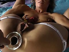 Arousing blonde slut Sheena Shaw likes drilling her tight ass with large toys and dildos