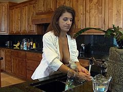 She's a good mommy and spends some time in the kitchen cooking. Well after a hard day of cleaning up and cooking this mom deserves a pleasant break. She takes that brake right there on the kitchen floor by fucking her pussy with a dildo. Will she make time for the main course, like a big hard cock?