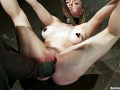 There's some fucked up stuff going on in this BDSM video where a busty blonde girl is experiencing some extreme bondage.