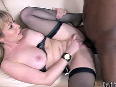 Cuddly blond milf in steamy black lingerie and stockings lays on her back while a horny black daddy drills her soaking pussy in missionary style.
