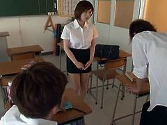Slutty Japanese teacher is playing dirty games with her male students. She shows them her cunt and allows the guys to finger and fuck it by turns.