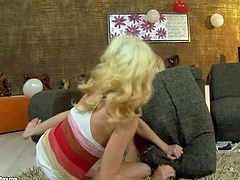 Tiffany Fox and Chary Kiss are crazy blondes that have wild lesbian sex on the floor in the middle of the room. Pretty girl with sexy tits gets dominated and pleased by another blonde chick.