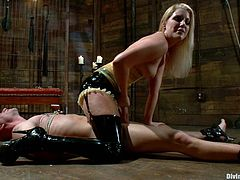 This latex mistress wants her slave to be very obedient, so she ties up and then whips him into shape. Yes, his ass turns completely red by the end.
