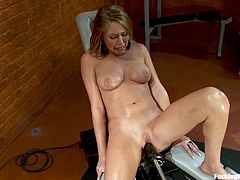 Press play on this hot scene and watch the smoking hot Brynn Tyler having orgasm after orgasm as she's fucked by machine.