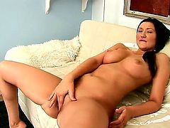 Busty brunette Vanessa Vaughn likes posing while gently fingering her wet pussy