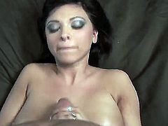 Great black haired babe Halie James with massive and sweet natural boobs caresses, sucks and strokes my dick in the pov scene till it presents her a cum load on the breast.
