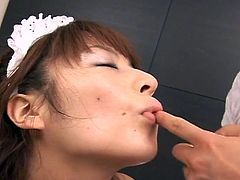 Akane Mochida is a busty asian maid. In this scene she gets her tight hairy pussy stimulated with a hitachi and sucks some cock!