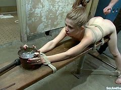 Slim blonde babe gets tied up and gagged in the locker room. After that she sucks a dick and gets fucked in her wet vagina.