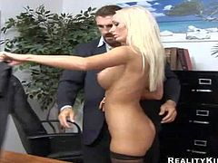 Stunning long haired blonde secretary Lichelle Marie with big jaw dropping hooters in short white skirt and black shirt seduces her muscled boss and get slicked good in the office