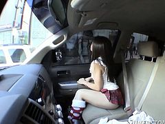 Adorable black haired Asian teeny chick takes a seat in huge van. She looks hot in her sexy mini skirt and her tiny red undies.