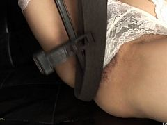 Well, this brunette from Japan is in white lingerie and gonna go solo. Slutty nympho with nice tits uses some stuff for stimulating her fluffy pussy. Dude, you just need to see this hot and a bit weird masturbation in Jav HD sex clip.
