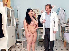 Bosomy long-haired mom Rosana lays on the medical lounge in order to welcome a zealous finger fuck with her spoiled punani.