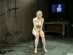 Curvy blonde Darling lets some guy put her into irons. The man ties the chick's boobs around and then destroys her vag with a dildo.