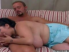Petite full figured black haired slut with french manicure and enormously big natural gazongas gets down on knees and gives lusty blonde to her tanned neighbor with muscled body and stiff pecker