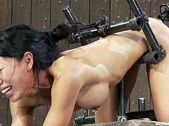 Tia Ling gets her snatch toyed hard in a hot BDSM vid