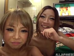 Two sexy Japanese girls in housemaid uniforms come up to guys and give them a blowjob standing on their knees.