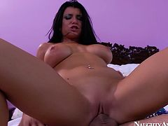 Busty bitch is riding hard dick like crazy. Her twins are bouncing intensively while she jumps. Then, Romi get poked hard from behind. Passionate sex scene filmed by Naughty America.