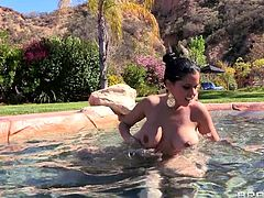 Kitty needs a hard dick in her naughty ass? Well now that won't be a problem as long Danny is around! She takes a swim and then Danny approaches her from behind. Soon the luscious brunette babe gets out of the water, bends over and receives a big thick dick in her ass. Danny is stretching her hole like a pro!