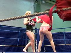 Attractive blonde Kathia Nobili with nice hooters and sexy body gets naked during amazing chick fight with furious black haired bitch Angell Summers and wrestle with her on the floor