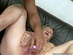 Fat short haired brunette granny with hanging tits rides on her handsome neighbor to loud orgasm on leather couch and gets her pink shaved cunt banged hard in close up
