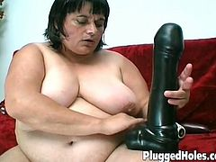 Big breasted bbw brunette getting her tight hairy pussy fucked with huge dildos! She didn't have an orgasm in a long time and enjoys every inch of these big toys!