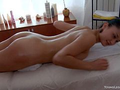 Teenage brunette Slevie is completely naked and demonstrates her perfect perky ass on massage table. She sweet Slevie her her body rubbed with her face down for your viewing enjoyment.