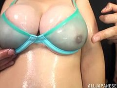 Busty Sakura Mano gets her body oiled up. After that she gets fucked between her tits. After that the gets pounded deep and hard in her pussy.