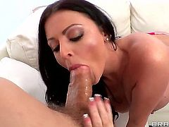 Sophie Dee is having fun with that big toy, cumming and squirting all over the place. She then takes a dick in her mouth and sucks it like a slut she is. She is sporting hot stockings all the way through.