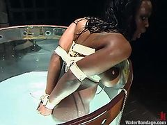 Busty Black chick gets bonded and then toyed with a vibrator. After that the guy put her in an aquarium and drowns her there.