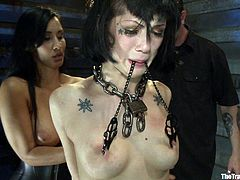 Watch this sexy brunette having her big tits squeezed by many clothes pins in this bondage clip where both her master and mistress have fun with her.