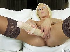 Superb blonde babe gets her sweet pussy toyed with a dildo