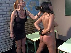 Naked handcuffed brunette Leilla with huge natural tits stands still in the middle of the classroom and gets her big bare butt spanked by lesbian mistress Katy Parker. Watch curvy naked lady get whipped.