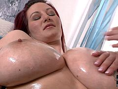 Carol and Vanessa are curvy and busty. Huge titted chubby redhead bares it all and then gets caressed by lesbian masseuse. They love each others enormously big juicy titties. Watch busty lesbians have fun.
