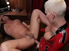 Christian and lustful blonde ladyboy Danni Daniels are having a good time indoors. They caress each other and then the tranny destroys the dude's ass with her massive dick.