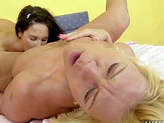 Sweet young girl Bettina Dicapri with long black hair and mature blonde Orhidea have lesbian sex on a king size bed. Watch young lesbian chick get her pussy and butthole tongue fucked.
