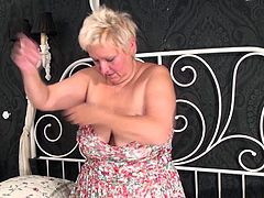 Take a look at those giant tits that Christine T. has. This mature lady has such giant saggy tits that she can lift them up and suck on her own nipples. She kneels on the end and plays with her pussy at the same time.