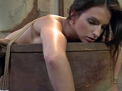 Pale innocent looking slender brunette with natural boobies gets tied up on rusty barrel and tortured by smoking hot mature cougar with huge tits and firm ass in tight dress