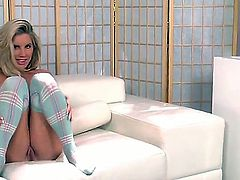 Pretty young glamour chick Ainsley Addison sitting on couch nude but in sexy stockings and pleasing herself with hot masturbation!