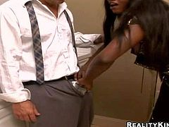Diamond Jackson is a dark skinned hot MILF with gigantic hooters. She bares her huge melons to seduce white man. She drops on her knees and gets face fucked by white cock. Watch busty black woman is dick hungry!