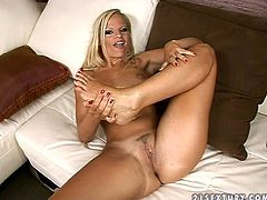 Pretty fair-hiared chick Nancy Bell drives her man crazy with a fantastic footjob and lets him lick her toes and shaved pussy.