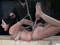 Adorable brunette in corset gets tied up and hosed. After that she also gets her pussy toyed with a vibrator and big dildo.