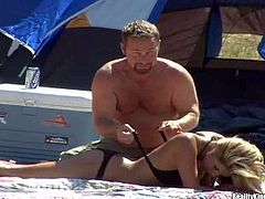 Busty blonde milf in black underwear sucks cock in tent