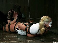This blonde chick is a masochist. She allows to do crazy things with her. She gets chained and tortured. Later on she also gets fucked with some big thing.