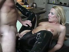 Wonderful blonde babe in sexy black latex pants is having an awesome cock shoved inside of her small mouth and then is fucking her right in her asshole.