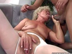 Experienced cock addicted short haired blonde granny Effie with blue eyes and hanging tits in white stockings and high heels gives head to young buck in point if view