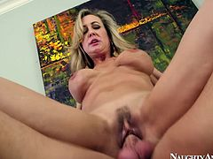 She is attractive MILF hoe with strong blowjob skills. Watch her working her talented mouth on a meaty cock of a young handsome guy.