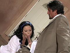 Curly brunette Loni Evans gives a romantic blowjob