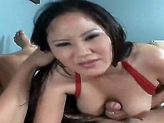 Horny naughty asian bitch Jessica Bangko enjoys sucking and licking a  big dick in her mouth.