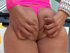 Attractive cury brunette Kimberly Kane dressed in pink shows off her nice big bottom before she takes off her thong. Then naughty girl spreads her big butt cheeks and gives a closeup view of her anal hole!