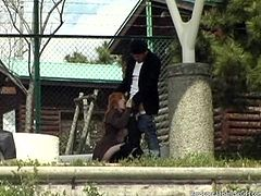 Get a load of this outdoors clip where a sexy Asian babe sucks and fucks a guy's hard cock in a public place.